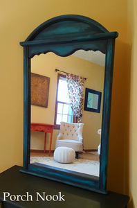 "EXAMPLE: Mirror w/ ""The Real Teal"" and ""Charcoal"", clear and dark wax"