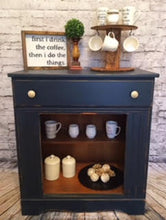 "EXAMPLE: Cabinet stand w/ ""After Midnight"", designed by Southern Furniture Flippers in Pembroke, GA"
