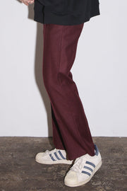 SOLID CREASE SIDE ZIP FLARE TROUSERS