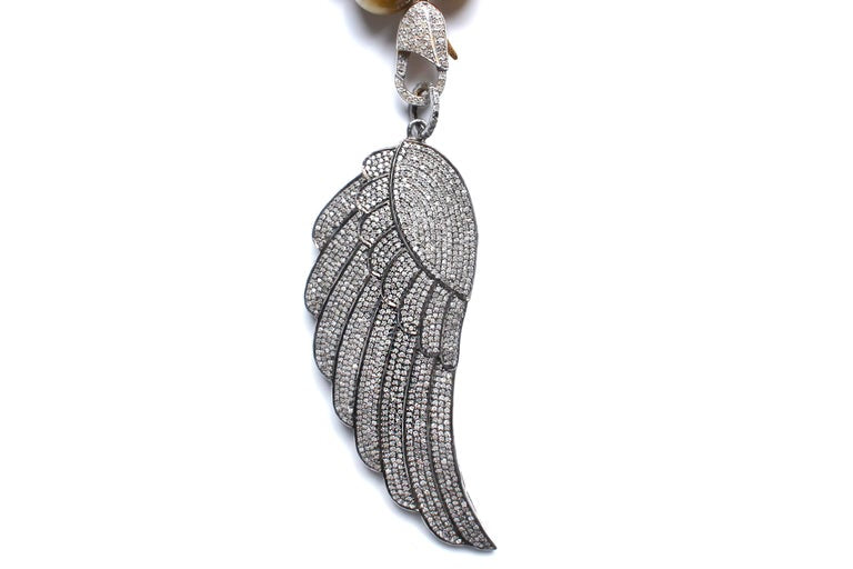 Onyx, Diamond, Enamel Red Threaded Angel Wing Pendant Necklace