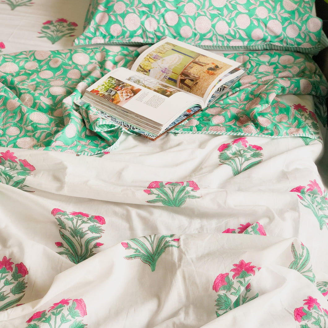 pink and green floral bedsheet