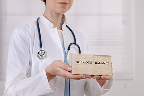 doctor holds hormones sign