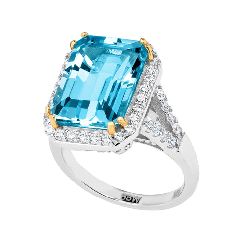 Sterling Silver 8 Carat Blue Topaz Emerald Cut Ring with 18 KGP Prongs