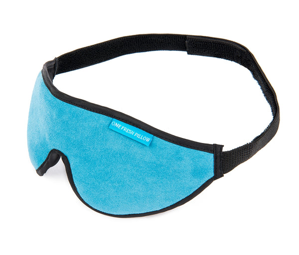Aqua blue sleep mask with black border, side view