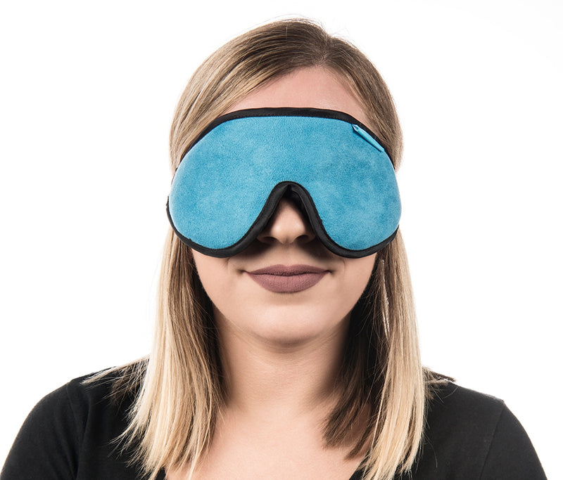 Aqua blue sleep mask with black border, shown on model