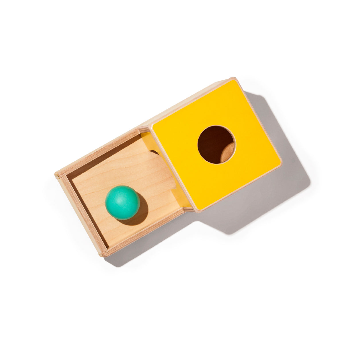 box with a hole for a ball and drawer