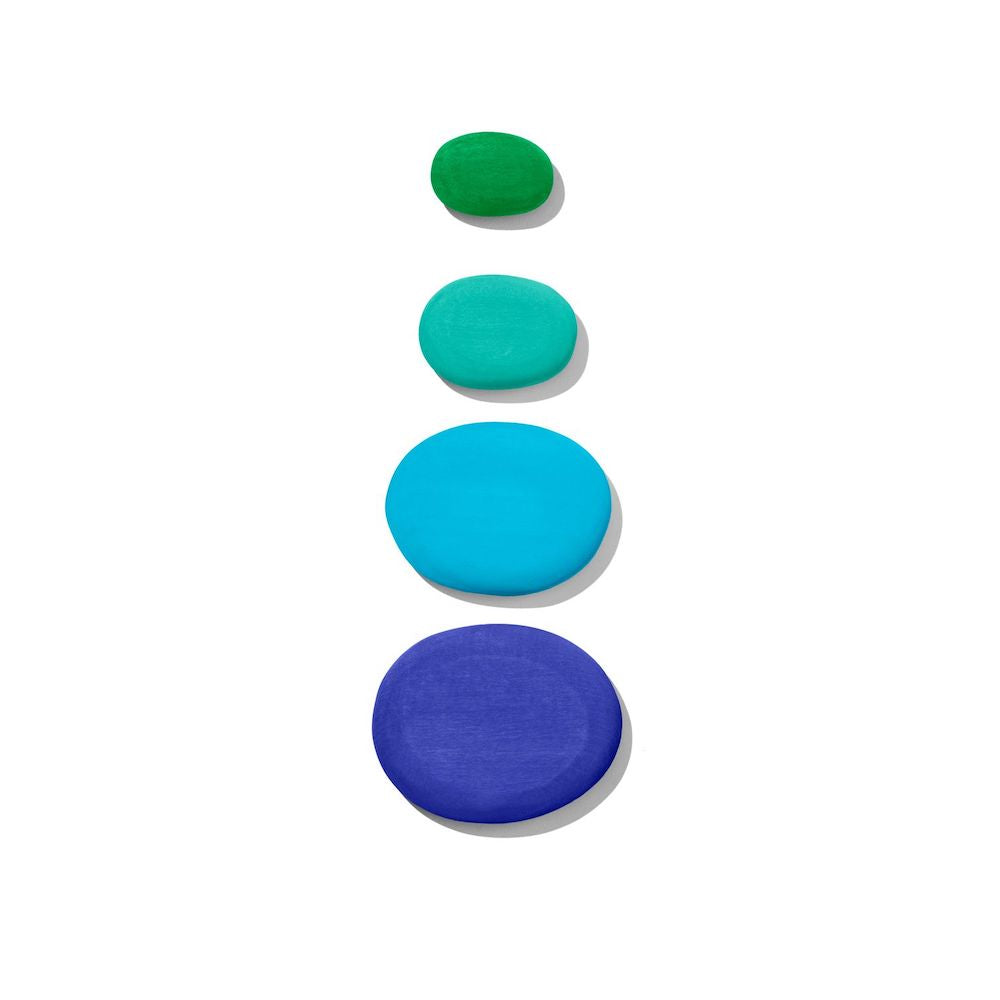four differently sized wooden stones in shades of blue