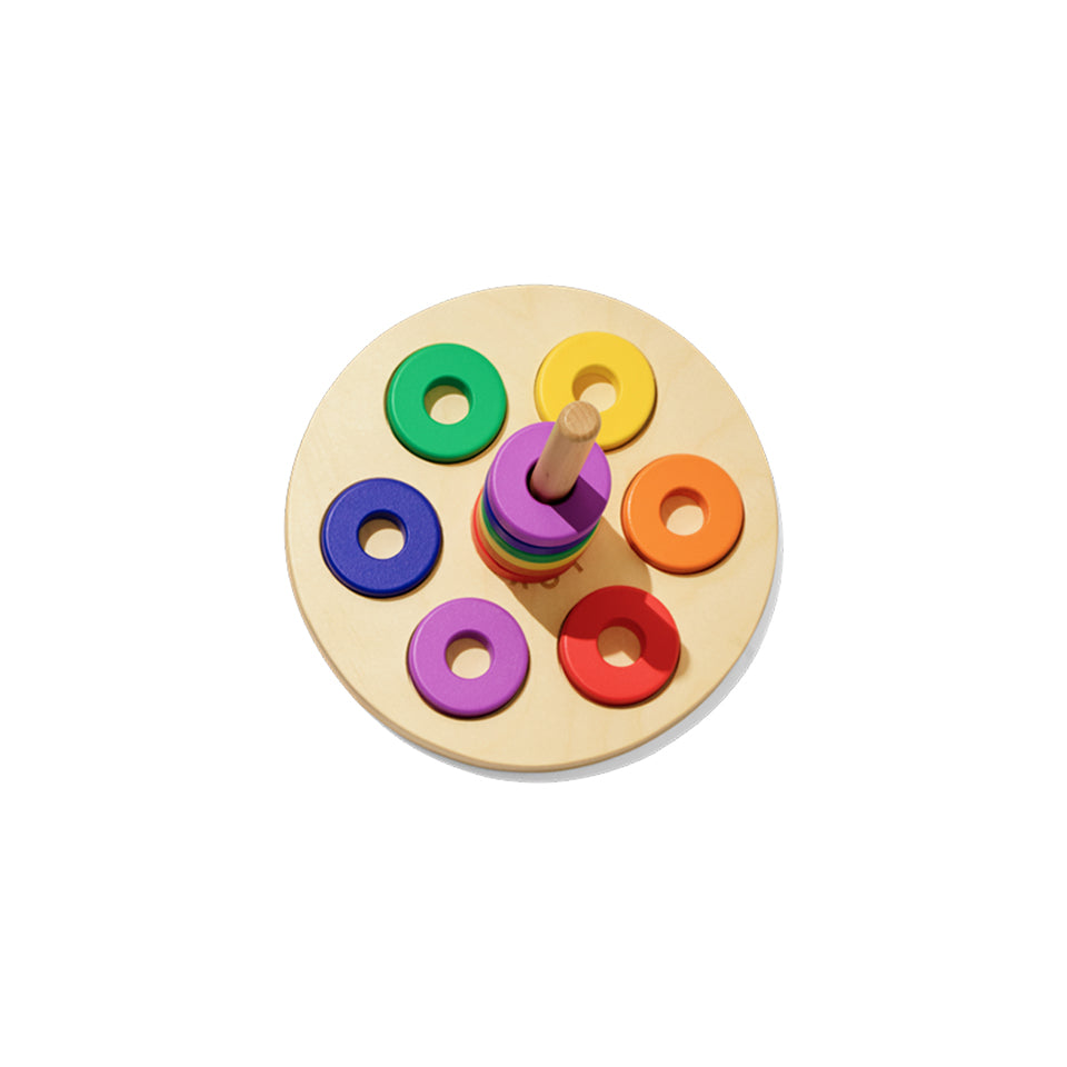 wooden stacker and colourful wooden circles with holes