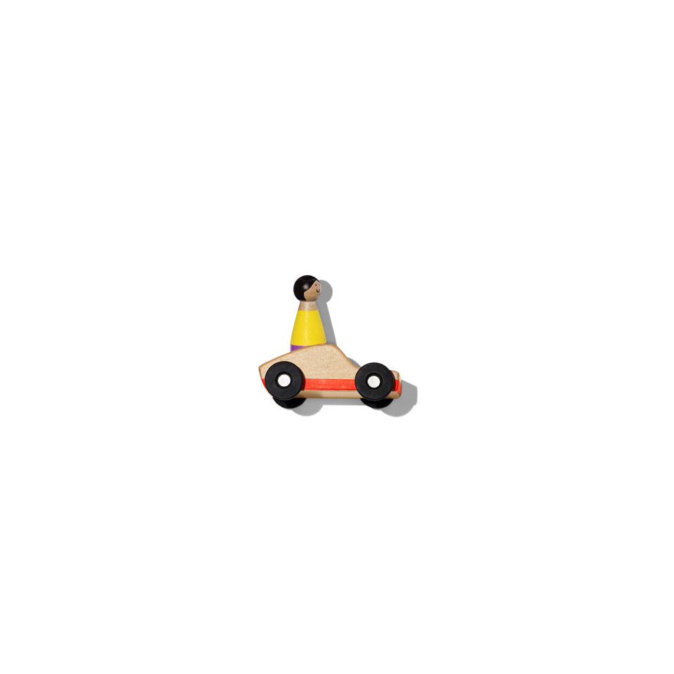 small wooden car with human figure riding on it