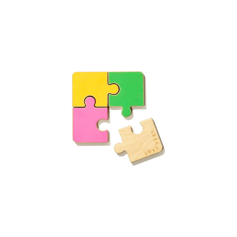 four wooden pieces of puzzle