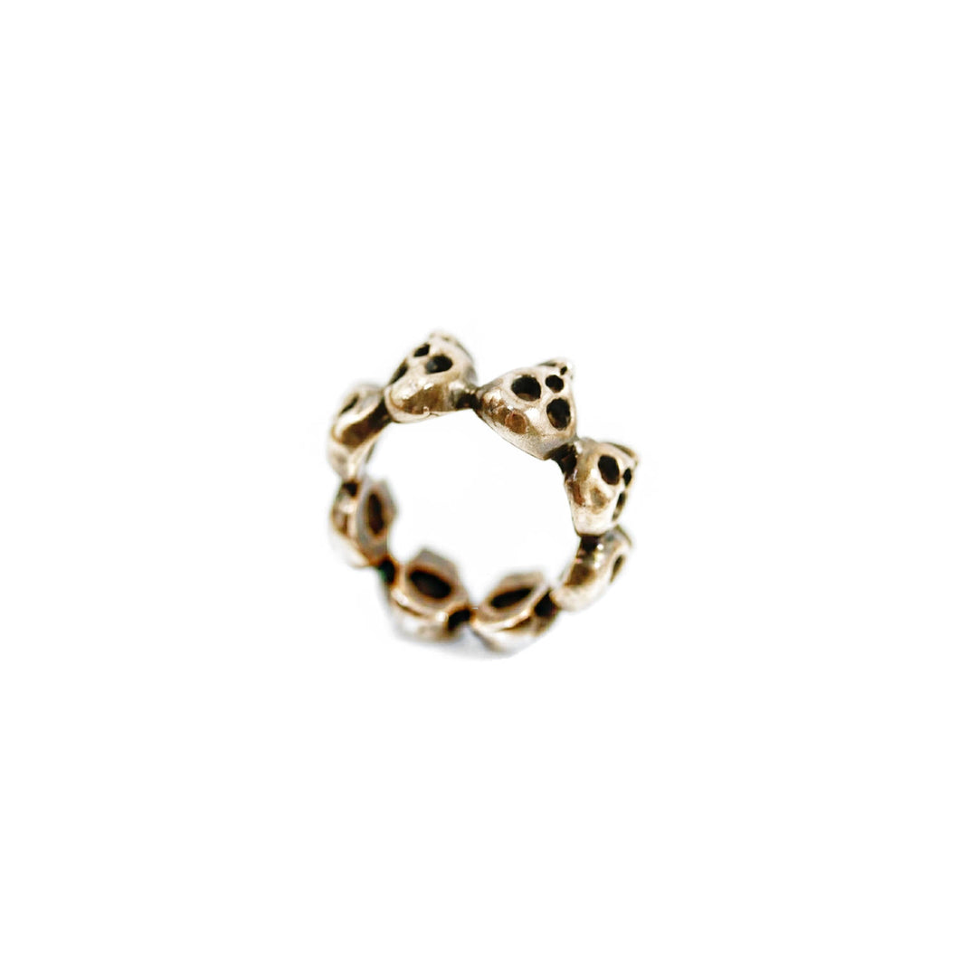 Rose Brass 8-Skull Band Ring
