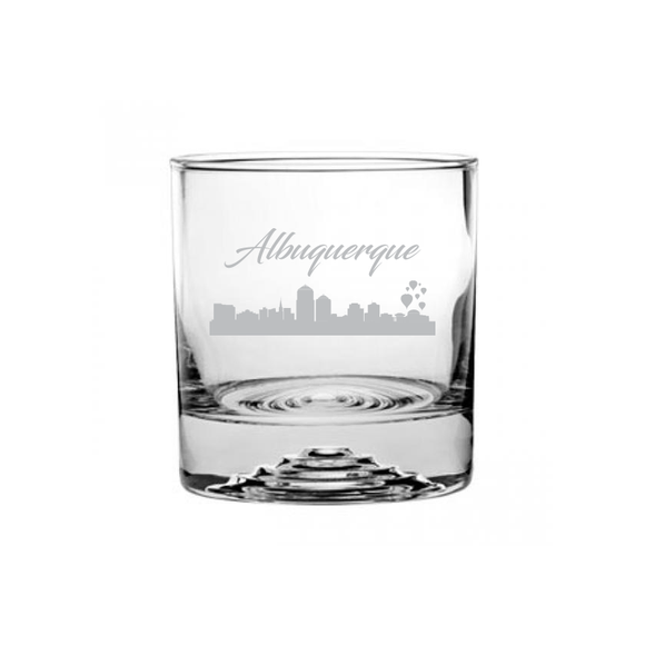 This is a rocks glass etched with a skyline silhouette of the City of Albuquerque New Mexico Cityscape.