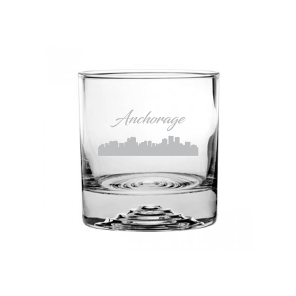 This is a rocks glass etched with a skyline silhouette of the City of Anchorage Alaska Cityscape.
