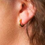Joy Hugger Earring crafted by women transitioning out of homelessness using 100% recycled metals