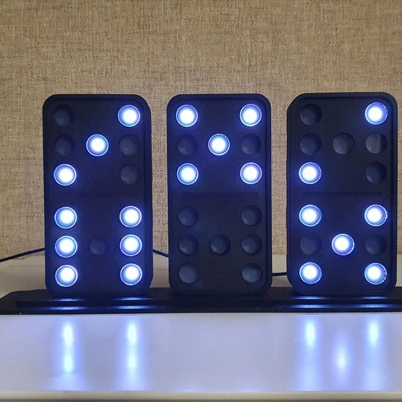This DIY domino clock tells the time using three LED-lit tiles