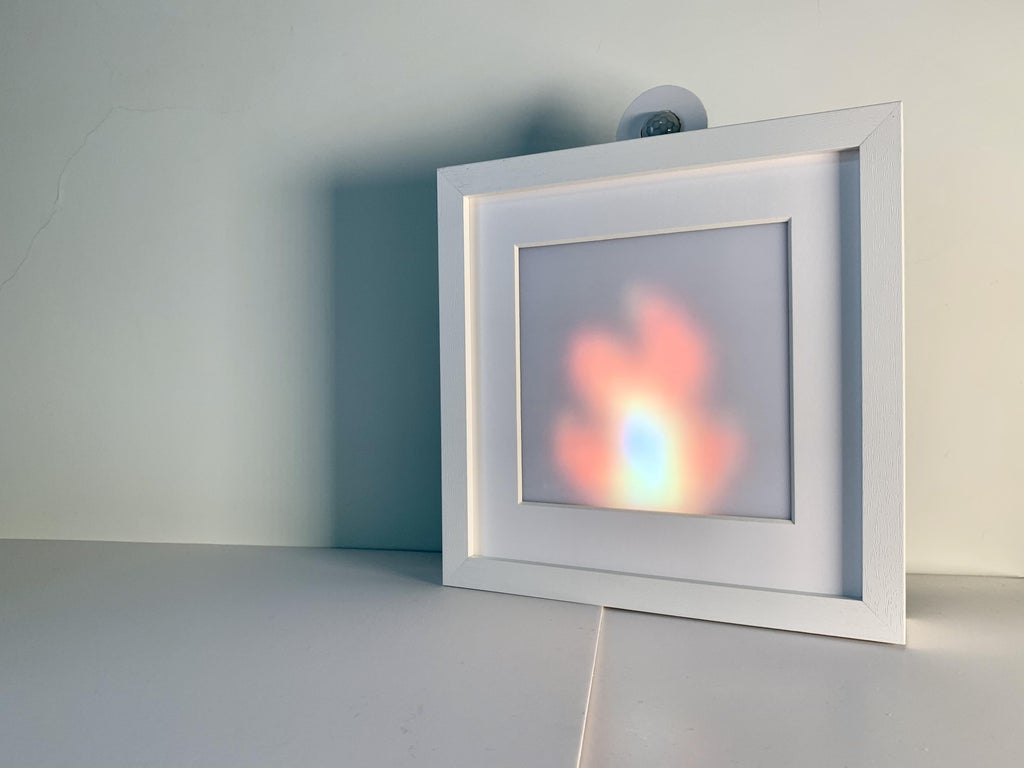 Living Pixels is a light frame that comes alive when you leave