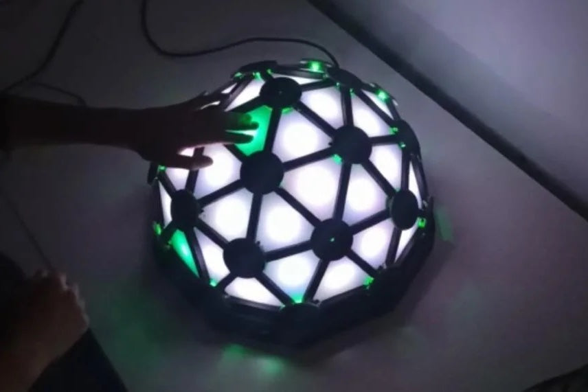 Play Simon and the piano on this glowing geodesic dome