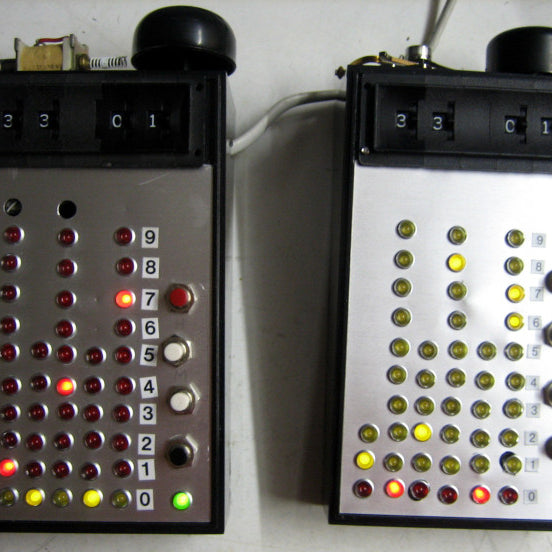 Build a clock using logic ICs, lots of LEDs and a loud bell