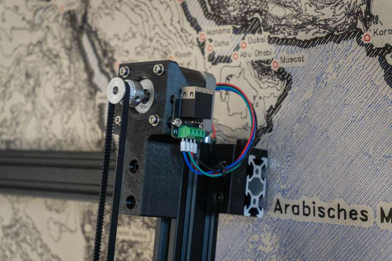 This pen plotter draws detailed maps the size of walls