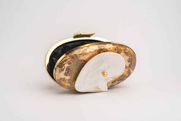 Margaruite oyster oval clutch with South Sea Pearl