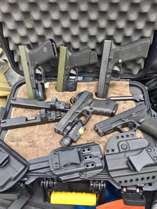 Glock Pistols with a variety of setups and holsters