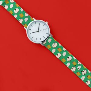 A 40mm unisex stainless steel quartz powered watch with a Dumplings pattern printed on the strap