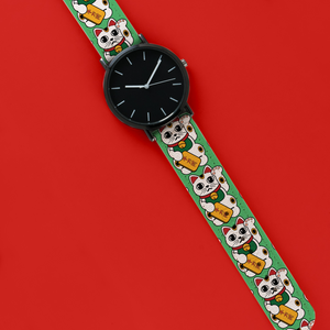 A 40mm unisex stainless steel quartz powered watch with a Lucky Cat pattern printed on the strap