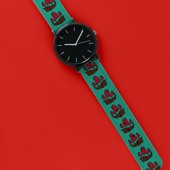 A 40mm unisex stainless steel quartz powered watch with a Sailing Junk pattern printed on the strap