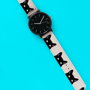 A 40mm unisex stainless steel quartz powered watch with a Peeping Tom Cats pattern printed on the strap