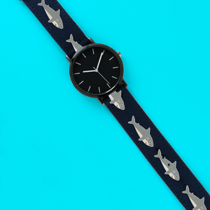 A 40mm unisex stainless steel quartz powered watch with a Sharks pattern printed on the strap