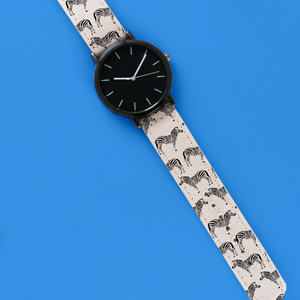 A 40mm unisex stainless steel quartz powered watch with a Zebra Safari pattern printed on the strap