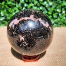 Load image into Gallery viewer, Rhodonite Sphere ~ Small - The Crystal Society Pty Ltd