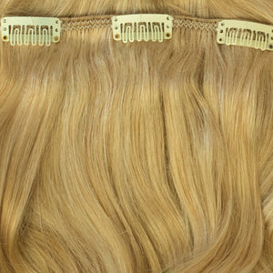 highlighted clip in human hair extensions