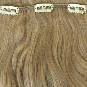 medium blonde clip in hair extensions highlighed