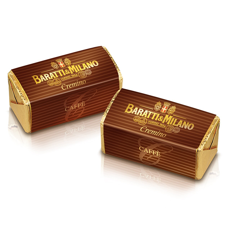 Two beautiful Baratti and Milano Caffe Cremino wrapped in gold foil and brown stripe paper on a white background.