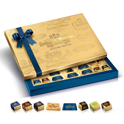 The Baratti and Milano Assorted Chocolates in Elegant Gold Gift Box with Bow is covered in matte gold paper featuring embossed Baratti & Milano logos from the archives. These lovely boxes are handmade in Turin by a small family company and adorned with a simple bow in Baratti & Milano's signature deep blue. Inside you'll find a selection of some of Baratti & Milano's most loved classics, including five varieties of cremino, classic and dark gianduiotti, and solid 70% dark chocolate squares.