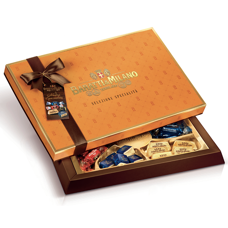 A beautiful orange assorted chocolate box with a brown bow, with the lid slightly lifted to see the assorted Baratti and Milano chocolates inside