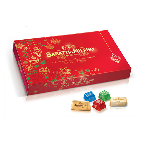 Image is of Baratti & Milano Holiday Box with Assorted Fine Chocolates and is a splendid Christmas red rectangular shaped box with whimsical depictions of gold and green stars and ornaments. In front of the box are images of the chocolates that arrive with this assortment. All on a white background.