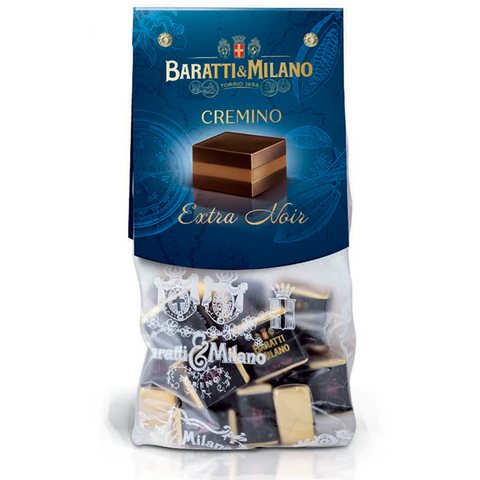 Baratti And Milano hazelnut cremino Extra Noir extra dark chocolate comes in a peek a boo style baggie aloowing you to see the individually wrapped Cremino in an elegant black and gold. All on a white background.