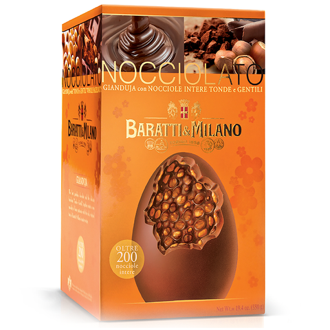Baratti & Milano Giant Artisan Made Giandiuja Hazelnut Easter Egg is an extra large chocolate egg crafteded by select artisans in Piemonte. The giant egg is 550 grams, over one pound. Packaged in an elegant orange with an image of the large egg cracked open to witness the splendor of the hazelnuts inside the chocolate. Background images on the packaging include whimsical depictions of flowers and shows you the smooth creamy chocolate pouring down and pictures of the large delectable hazelnuts.