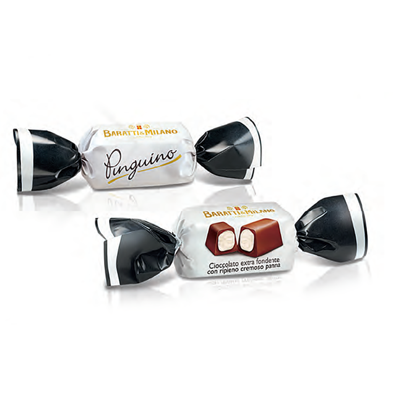 The Baratti and Milano Pinguino is playfully wrapped like a candy in white and black pinched at the sides. Baratti and Milano logo in gold and an image of the unwrapped dark chocolate filled with a luscious white cream. Two pictures of the chocolates on a white background.