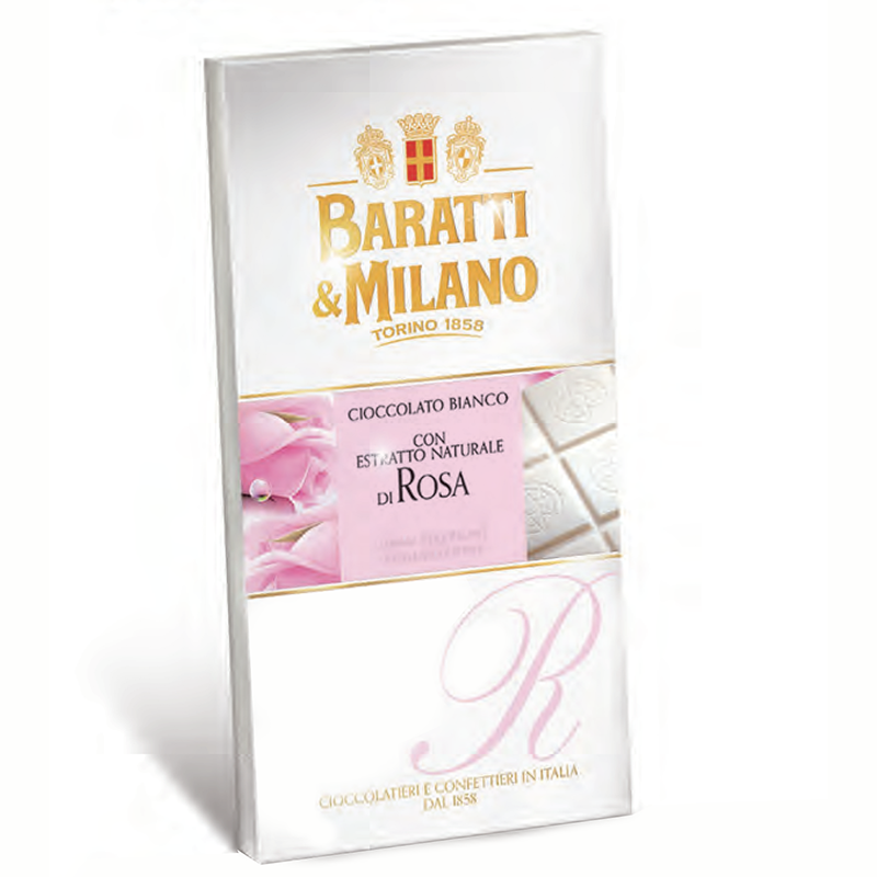 The Baratti & Milano White chocolate and Rose bar creates an amazing and new flavor with extravagance of rose embedded with the delicious white chocolate.Perfect for the lover of rose, Valentines Day, Mother's Day and any special occasion. The image shows the face of the bar covered in a white wrapping showing imagery of pink soft rose petals and the chocolate bar which has a hint of pink once unwrapped. Sealed of course with the Baratti and Milano Royal Crest.