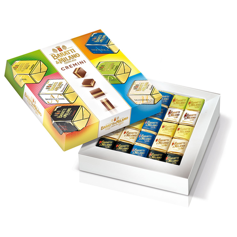Baratti & Milano Assorted Cremini Color Art Gift Box is a pop of fun and flavor! Image of box with artistic renderings of the cremini on fun colored backgrounds of blues, yellows and pink. The box is open to see the cremini inside individually wrapped. All on a white background.