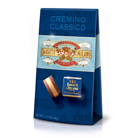 Baratti & Milano Ballotin of Cremino Classico, contains 6 pieces of the famous cremino chocolate. Packaged in a royal blue ballotin with imagery of Baratti & Milano logos and two images of the cremino. One version packaged in its signature blue and gold foil and the other shows the cremino uncovered to witness the majesty of the layer of hazelnut in the middle of two layers of Baratti & Milano creamy milk chocolate.