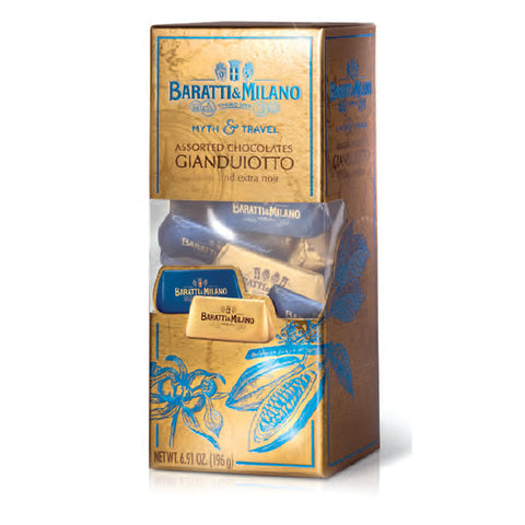 Baratti & Milano Myth and Travel Box Gianduiotto Classic and Dark Chocolates contains Classic gianduiotti and dark chocolate gianduiotti together at last. If you've been wanting to try them side by side, the Myth & Travel assortment is for you! Packaged in a gold and rectangular box with a peek a boo cut out allowing you to see the assortment of elegant gold and royal blue packaged gianduiotti. Covered in imagery of turquoise  cacao plants and Baratti & Milano logo.