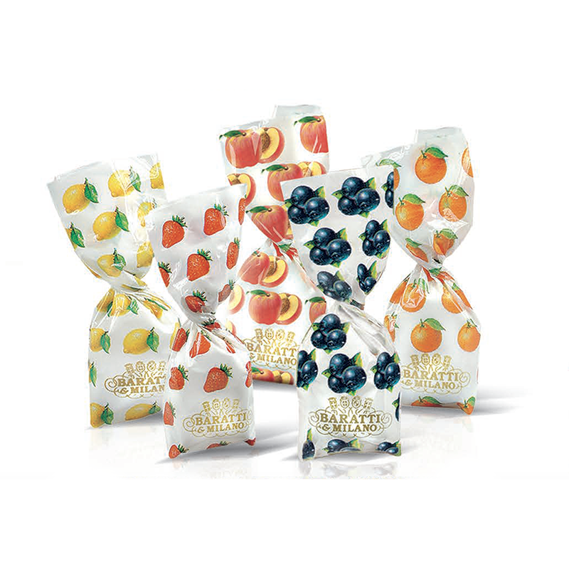Fruit Filled Hard Candies by Baratti and Milano Peach Lemon Orange Strawberry and Blueberry in beautiful wrappers on a white background.