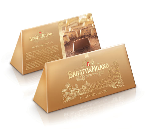 Baratti & Milano Gianduiotto Prism Gift Box is a beautiful gold prism-shaped box alike the iconic shape of the Baratti & Milano Gianduiotto and contains 200 grams of this world famous chocolate creation. Packaging has gold etchings of the Queen's Square in Turin whilst an uncovered Gianduiotto chocolate makes your mouth water on the other side of the Prism shaped gift box!