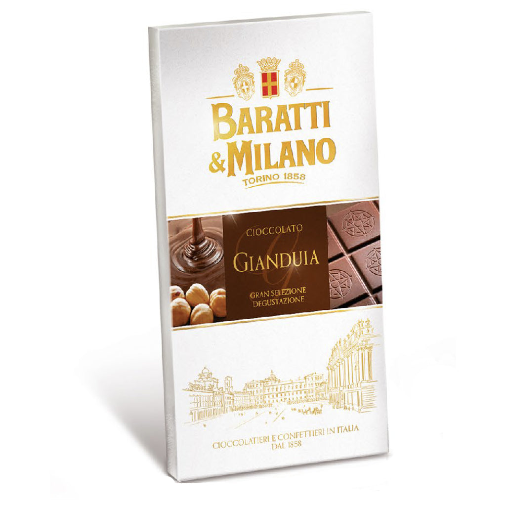 What makes the Baratti & Milano Chocolate Hazelnut Bar (Gianduja) special is the hazelnut paste in the chocolate. The smooth, creamy Gianduja melts on your tongue and transports you into a state of bliss. Packaged in an elegant white with a backdrop depiction of the Queen's Square in Turin, Italy. Images of creamy chocolate falling onto delicious whole hazelnuts cover the packaging alongside Baratti & Milano logo written in gold.
