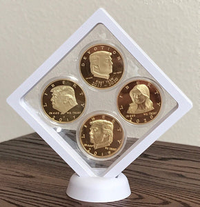 Four Trump and Melania Coins + Display Case