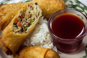 pork and vegetable eggrolls with kents sweet and spicy honey and hot sauce